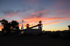 Sunset over carnival rides Stock Photography