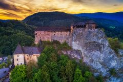 Sunset over a castle in Slovakia stock images