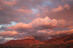 Sunset over Catalina mountains in tucson, arizona. Big sky at sunset full of monsoon clouds rolling over the catalina mountains at  in Tucson, Arizona Royalty Free Stock Images