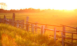 Sunset over cattle crush. A beautiful glowing African sunset captured over an old cattle crush royalty free stock images
