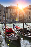 A sunset over the channel and gondolas, Venice, Italy Royalty Free Stock Photography