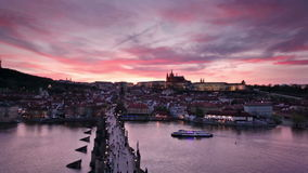 Sunset over Charles Bridge and Prague Castle, Czech Republic stock video footage