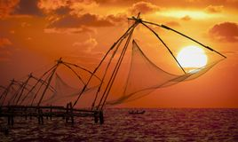 Sunset over Chinese Fishing nets in Cochin. Sunset over Chinese Fishing nets and boat in Cochin (Kochi), Kerala, India Stock Photos
