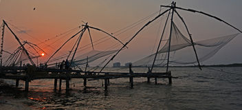 Sunset over Chinese fishing nets. Sunset at Chinese fishing nets of Cochin in the state of Kerala, India Royalty Free Stock Images