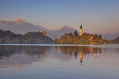 Sunset over the church and lake in Bled, Slovenia Royalty Free Stock Image
