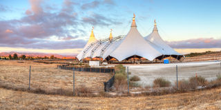 Sunset over a circus tent stock photography