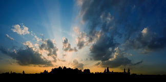 Sunset over the city. The sun shining through low cloud Royalty Free Stock Photo