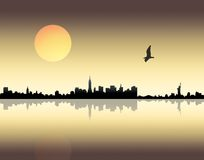 Sunset over city. Panoramic view of a city over sunset background Stock Images