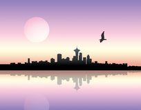 Sunset over city. Panoramic view of a city over sunset background royalty free stock images