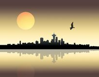 Sunset over city. Panoramic view of a city over sunset background royalty free stock image