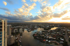 Sunset Over City At River Aerial Image