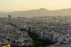Sunset over the city, the city in the yellow sunlight, Athens stock photos