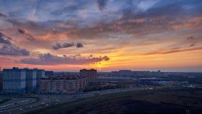 Sunset over city Stock Photos