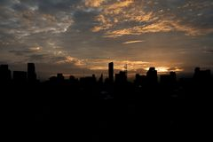 Sunset over the city with clouds sky. Natural concept Royalty Free Stock Images