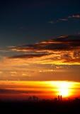 Sunset over city horizon Royalty Free Stock Photography