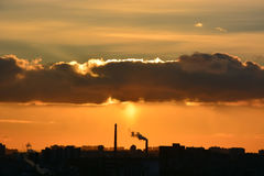 Sunset over the city. With industry pollution royalty free stock image
