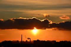 Sunset over the city. With industry pollution royalty free stock photo