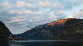 Sunset over city and lake Hallstatt stock video footage