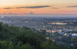 Sunset over the city. In the city landscape you can see the trai Royalty Free Stock Photo