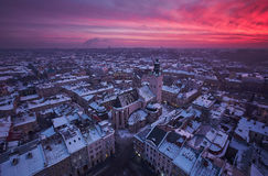 Sunset over the city Lviv. Twilight view of western european city Lviv, architecture background Royalty Free Stock Photos
