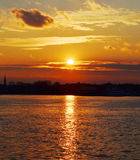 Sunset over city scape Stock Photography