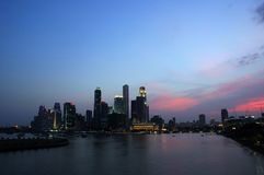 Sunset over city skyline stock photos
