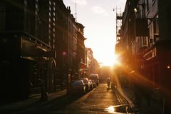 Sunset over city streets Stock Image