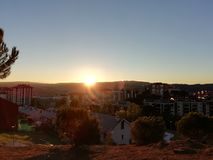 Sunset over the city. In a sunny autumn day stock images