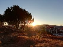 Sunset over the city. In a sunny autumn day stock image