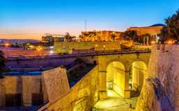 Sunset over city walls of Valletta Stock Image