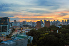 Sunset over Clarke Quay and Fort Canning Park Stock Photography