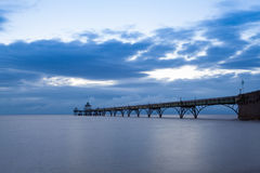 Sunset over Clevedon Pier, North Somerset, England, UK. Long exposure landscape image of sea and pier with the soft light at sunset, Clevedon, Somerset, England stock photo
