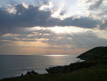 Sunset over Cliffs 2. Sun streaming through clouds near Baggy Point, Croyde, England Royalty Free Stock Photos