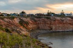 Sunset over over the cliffs at the Onkaparinga River Mouth at Port Noarlunga South Australia on 7th March 2019. Beautiful Sunset over over the cliffs at the stock image