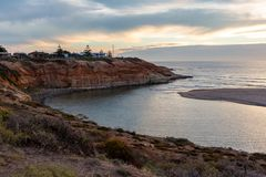 Sunset over over the cliffs at the Onkaparinga River Mouth at Port Noarlunga South Australia on 7th March 2019. Beautiful Sunset over over the cliffs at the royalty free stock photos