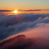 Sunset over the clouds Royalty Free Stock Photos