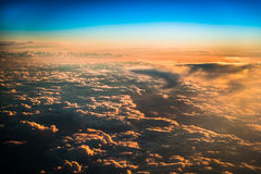 Sunset over the clouds Stock Images