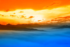 Sunset over the clouds Stock Image