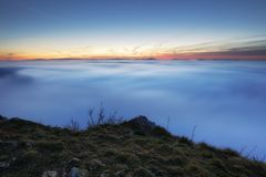 Sunset over clouds. At sunset Royalty Free Stock Photography