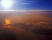 Sunset over a clouds. View from aircraft window Stock Photo