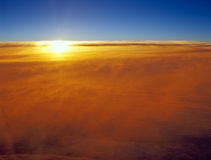 Sunset over a clouds. Royalty Free Stock Photos
