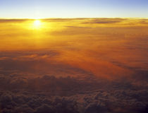 Sunset over a clouds. Royalty Free Stock Image