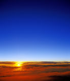 Sunset over a clouds. Stock Photography