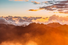 Sunset over cloudy mountain range