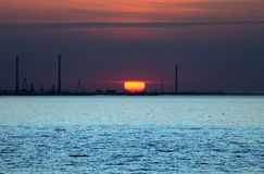 Sunset over a Coast. This image shows a sunset over a coast royalty free stock photography