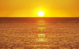 Sunset over the coast Stock Photos