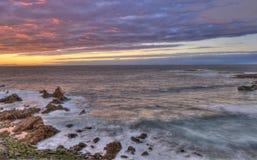 Sunset over coast Stock Photo