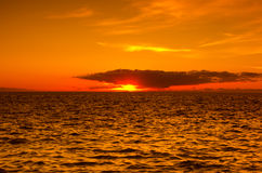 Sunset over the coast of Atlantic ocean Royalty Free Stock Photography