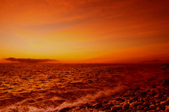 Sunset over the coast of Atlantic ocean Stock Photos