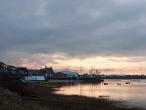 Sunset over coast ocean bay water sky sea boats docks. Essex; england; uk Royalty Free Stock Image